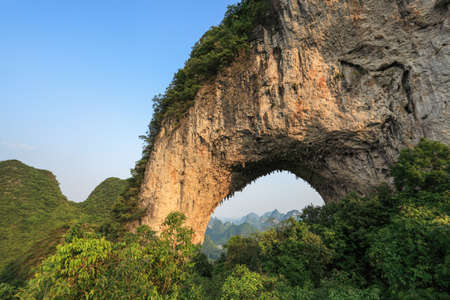 karst: the moon hill arch, famous karst mountain landscape in yangshuo,China Stock Photo