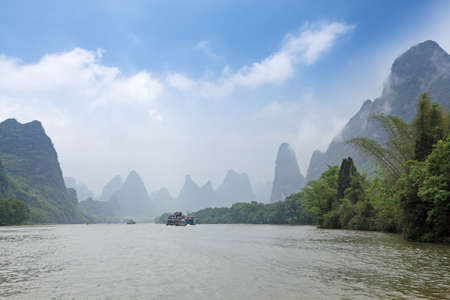 cloud and mist amidst the lijiang river,guilin,China photo