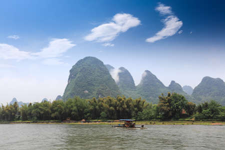 beautiful scenery of lijiang river, karst mountain landscape under blue sky in guilin,China photo