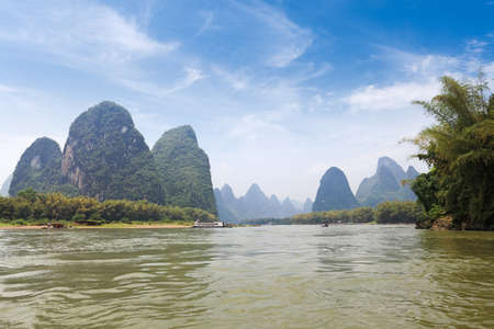 beautiful lijiang river in guilin,karst mountain landscape under blue sky ,China photo