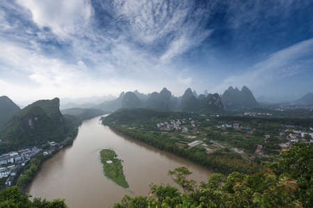 karst landform and the lijiang river after the rain under blue sky in yangshuo,China photo