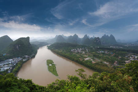 overlooking the karst landform and the lijiang river after the rain at green lotus mountain peak in yangshuo,China photo