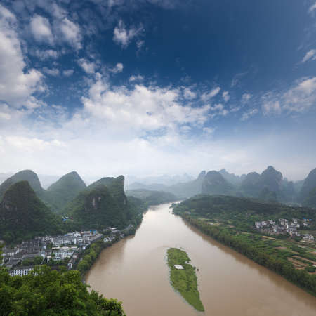 turbid: karst landform and the lijiang river against a blue sky in yangshuo,China