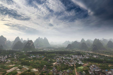 beautiful karst mountain landscape against a blue sky in yangshuo,China photo
