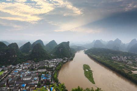 aerial view of karst landform and lijiang river at sunrise  in yangshuo,China photo