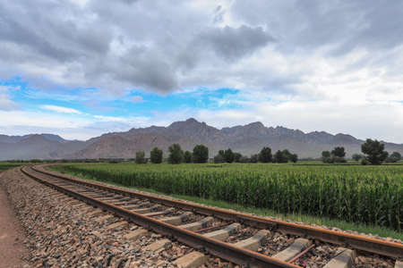 mongolia: railway under the yinshan mountains in inner mongolia