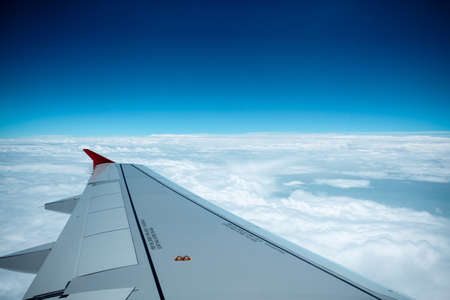 airfoil: aircraft wing on the clouds,flying background Stock Photo