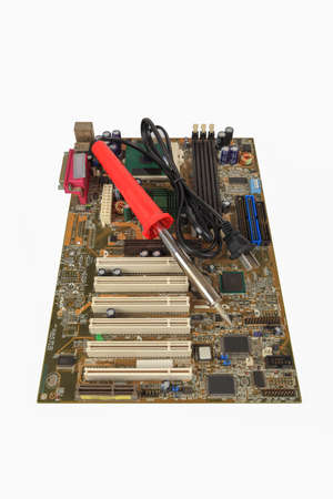 soldering iron and computer motherboard,repair concept Stock Photo - 14765218