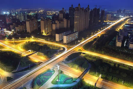 night traffic on the highway overpass in modern city photo