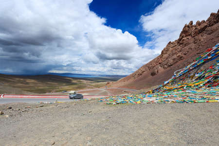 prayer flags,highway and sacred lake in tibet Stock Photo - 14973885