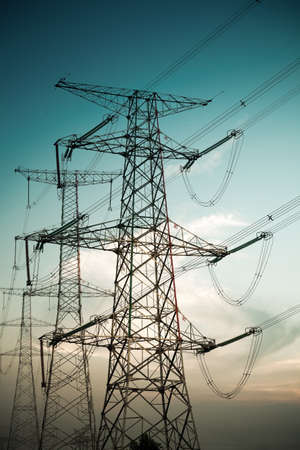 power line tower: high voltage cable pylon on blue sky background