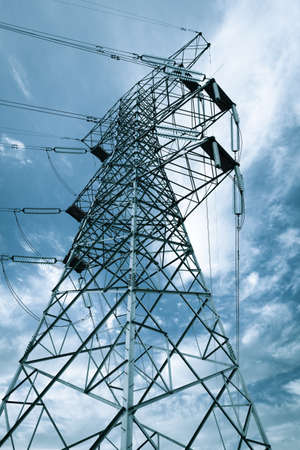 high-voltage transmission tower against a blue sky background photo
