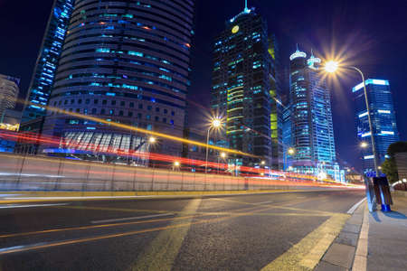 busy city: chinese modern city at night,light trails on the street in shanghai Stock Photo