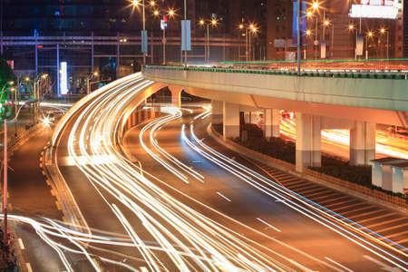 light trails on the viaduct ramp,  night traffic rush hour photo