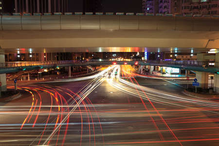 light trails on the crossroads at night in shanghai photo