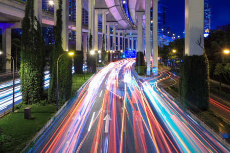 light trails under the elevated road at night in shanghai Stock Photo - 15734609