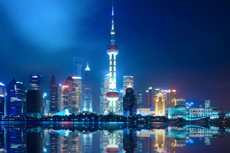 night shanghai skyline with reflection ,beautiful modern city photo
