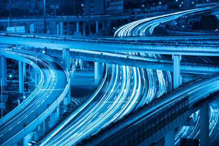 closeup of the light trails on highway viaduct Imagens