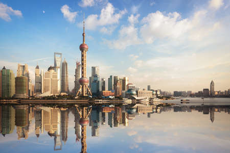 shanghai china: shanghai skyline at dusk with reflection,China Stock Photo