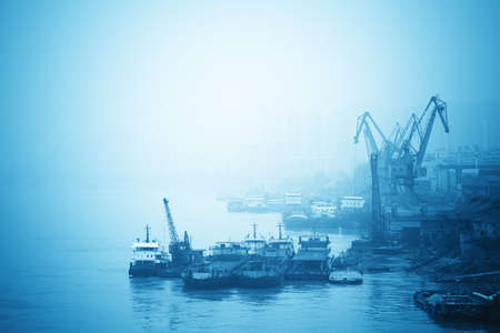inland: inland port with crane and cargo ship in yangtze river,China Stock Photo