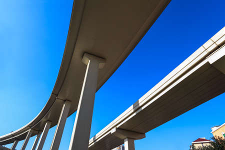 elevated road against a blue sky