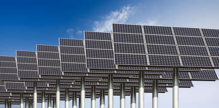 many solar energy panels against a blue sky photo