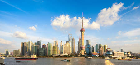 shanghai skyline: panoramic view of shanghai skyline with huangpu river at dusk