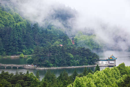 china lushan natural scenery,clouds and mist floating in the lake Imagens