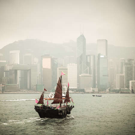 Hong Kong traditional wooden sailboat sailing in victoria harbor photo