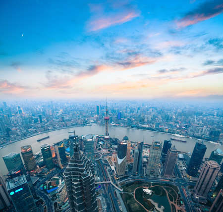 aerial views: birds eye view of shanghai panorama with beautiful sunset glow