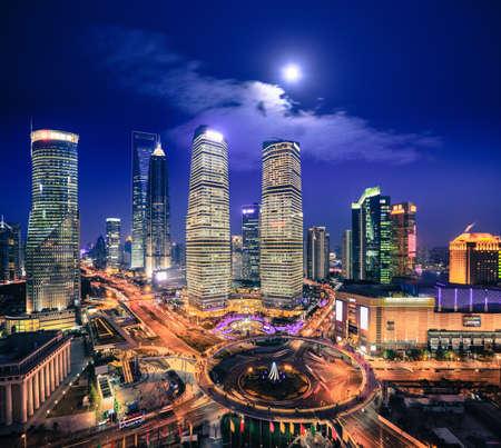 bird eye view: birds eye view of shanghai skyline at night with moonlight Stock Photo