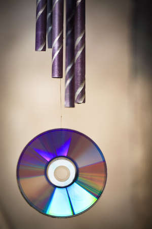 wind chime and cd rom disk rainbow colors photo