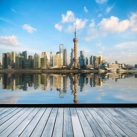 shanghai china: shanghai skyline in afternoon and reflection with wooden floor Stock Photo