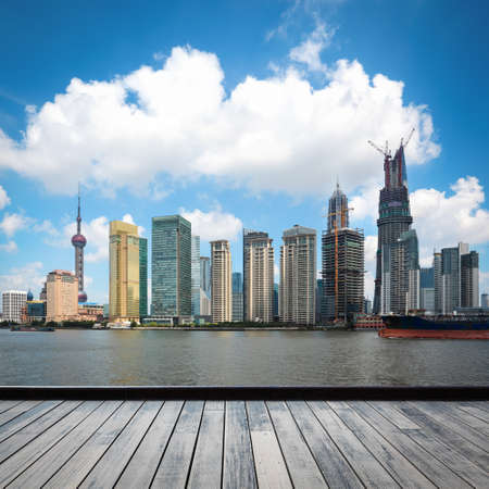 the development of shanghai skyline with wooden floor Stock Photo - 17617081