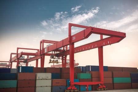 intermodal: container terminal at dusk,economic boom background Stock Photo