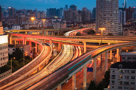 infrastructure: elevated overpass of the light trails, beautiful curves in shanghai