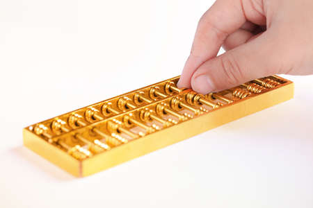 accountancy: golden abacus closeup,traditional finance concept background