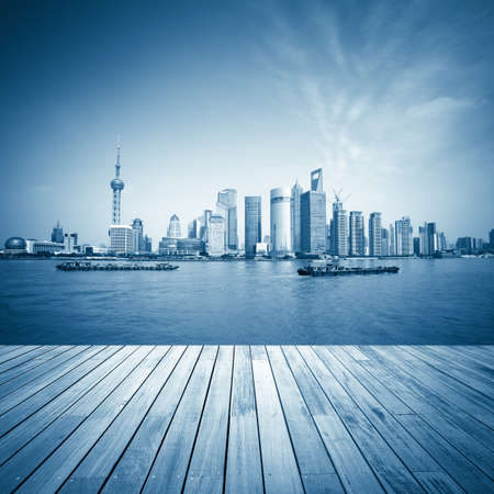 shanghai skyline and wooden floor with blue tone,beautiful scenery of the huangpu river  photo