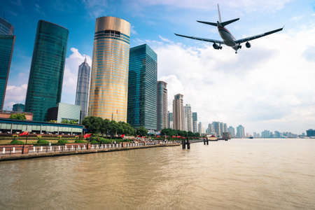 scheduled: modern city with scheduled flight in shanghai Stock Photo
