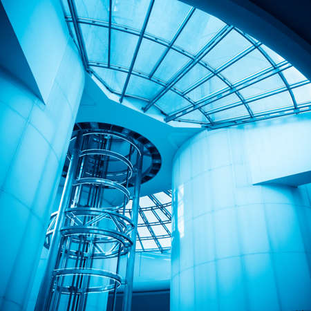 blue tone: elevator in the modern tower,futuristic blue tone