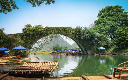 guilin: old stone arch bridge in yulong river ,yangshuo,China