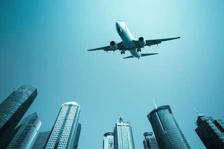 scheduled: scheduled flight with modern buildings skyline in shanghai