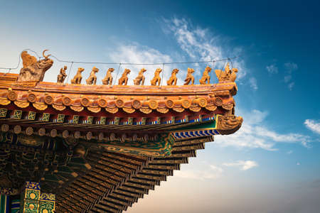 the eaves of forbidden city on the hall of supreme harmony ,the highest level of ancient architectural style in China  photo