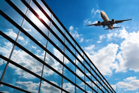 airport business: glass curtain wall and aircraft against a blue sky