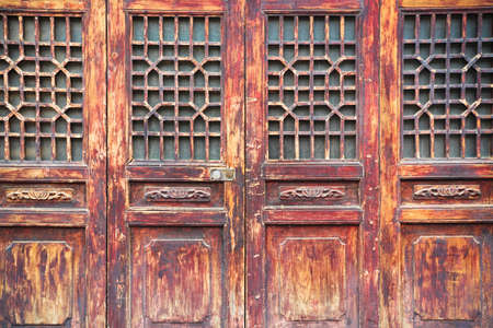 chinese traditional wooden door with a beautiful lattice window photo