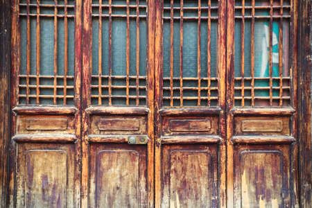 lattice window: chinese traditional wooden door has a beautiful lattice window