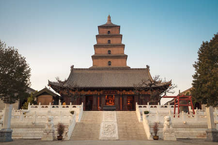 chinese pagoda: the great buddha's hall with giant wild goose pagoda at dusk ,Xian, China  AD 652