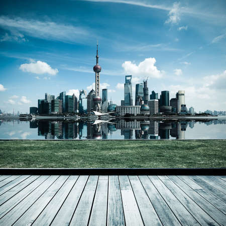 shanghai china: shanghai skyline with reflection and wooden floor and lawn