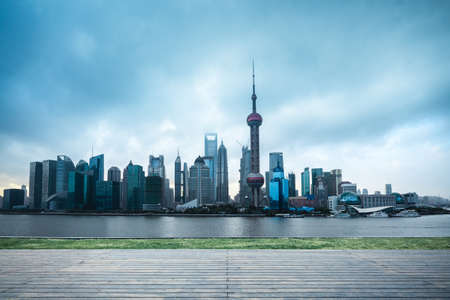 shanghai skyline in cloudy with wooden floor and lawn