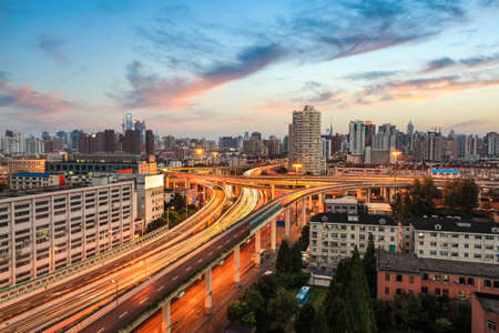 elevated: shanghai elevated road at dusk,modern city traffic view